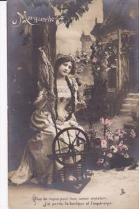 RP; Tinted, Marguerite, Sitting a spinning wheel outside a cottage, PU-1907