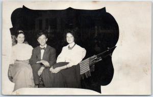 c1910s RPPC Real Photo Postcard 2 Girls & a Boy on Hammock Studio Portrait