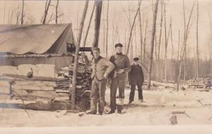 RP, Three Loggers Standing By Woodstack, 1904-1918