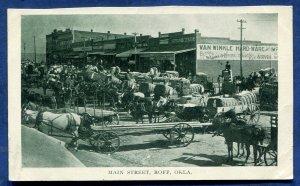 Roff Oklahoma ok Main Street horses carts cotton bales old postcard