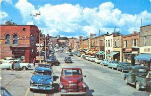 Huntsville Ont. Canada Street View Store Fronts Old Cars Postcard
