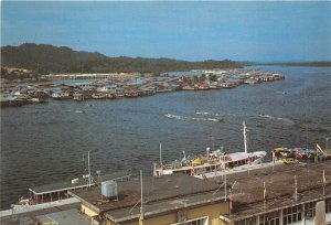 us8169 state of brunei harbour in foreground and floating houses in centre