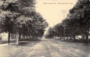 Evansville Wisconsin~East Main Street~Neighborhood Homes~Dirt Road~1909 Postcard