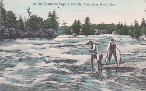 NORTH BAY , Ontario , Canada, 00-10s Men fishing at Chaudiere Rapids, French Riv