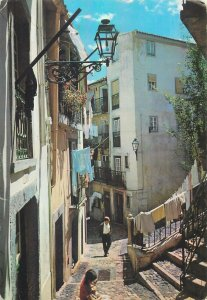 Postcard Portugal Lisboa typical street of alfama architecture balcony citizens