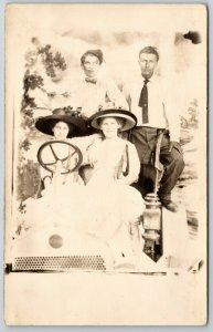 RPPC Goofy Bros Sit Behind Lovely Ladies w/Big Hats~Studio Prop Car~Winton? 1910