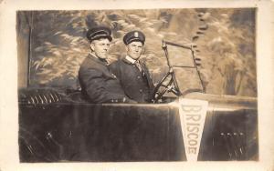 Real Photo Postcard~Studio Shot~Two Men in Uniform~Auto~Briscoe Pennant~c1915