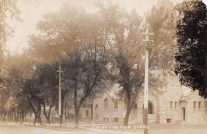 Hudson Michigan~West Main Street~Beautiful Stone Church Building~Fair Store RPPC