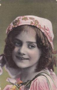 Portrait og girl wearing handkerchief on head, Green background, PU-1909