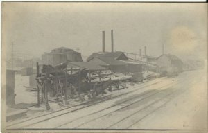 Vintage Real Photograph Postcard RPPC Lumber Yard with Railroad (Train) Tracks
