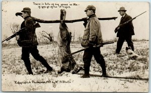 Vintage RPPC EXAGGERATION Postcard Hunters Carrying Giant Rabbit - Martin Photo