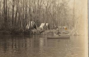 1904-18 RPPC Camping Trip on River Lake Tents Woman in Canoe Real Photo Postcard