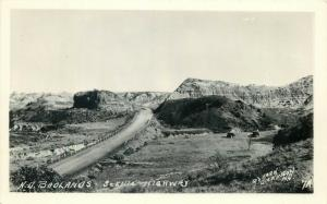 United States real photo postcard North Dakota Bad Lands scenic highway