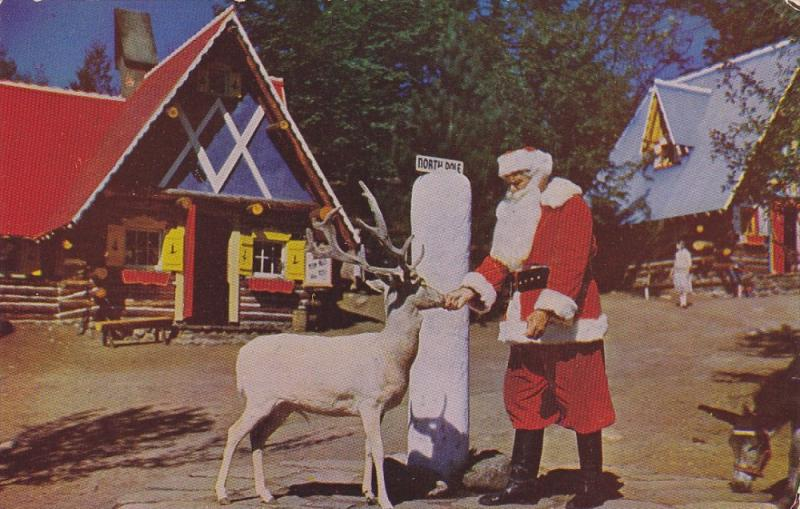 The North Pole, Santa and Blitzen, one of his reindeer, New York, 1940-60s