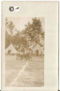 Military Camp with Soldiers Playing Field Sport with Tents in Background Vintage