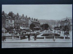 Wales LLANDUDNO Mostyn Street DEACON'S MOTOR COACHES Old RP Postcard by Bunney's
