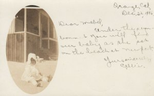 RP: ORANGE , California , Baby in sun bonnet sitting on beach, PU-1906