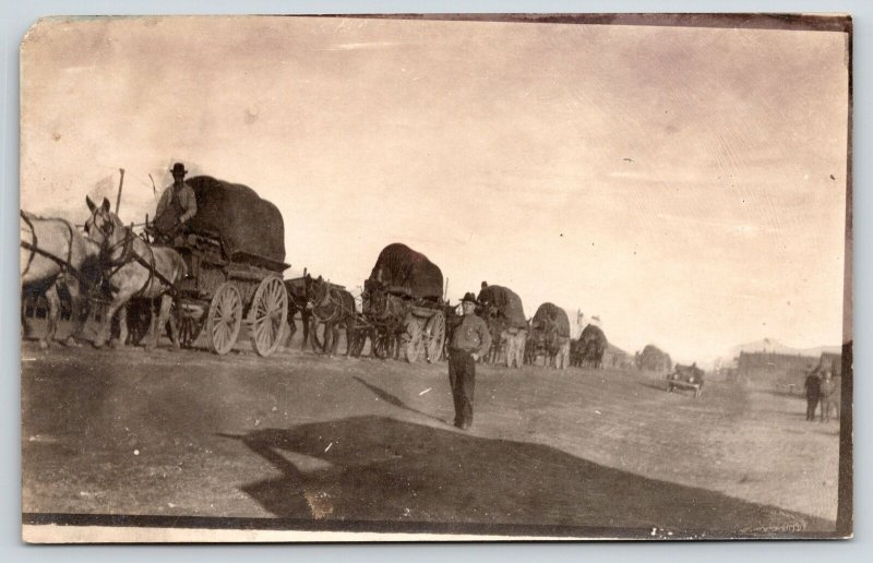 Real Photo Postcard~Wagon Train Pulls Out of Town~Vintage Car~c1908 RPPC