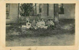 Postcard RPPC Children Sitting In Yard
