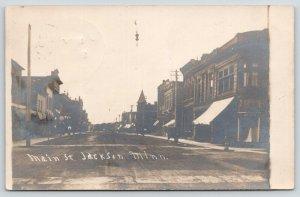 Jackson Minnesota~Main Street~Store Awnings~Hanging Lamp~Dirt Road~1908 RPPC