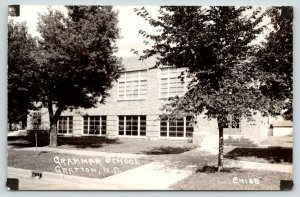Grafton North Dakota~Grammar School~Litter in Curb Sewer Drain~1940s RPPC