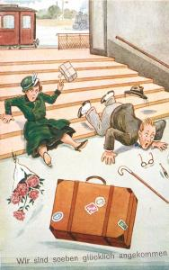 We are just happy arrived couple train station stairs comic accident suitcase