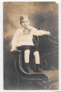 Antique RPPC Real Photo Postcard Small Boy Formal Clothes Boots Neck Bow Chair