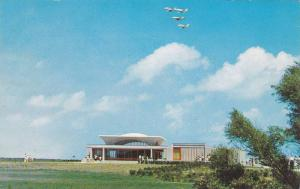 Modern aircraft over the Visitor Center, Wright Brothers National Memorial,  ...