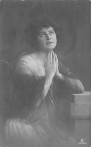 Black and White picture of a woman praying Writing on Back