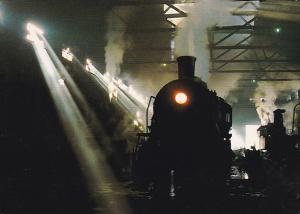 Steam Train Locomotive, Sunlight Smoke and Shadow Inside a Chinese Steam Depo...