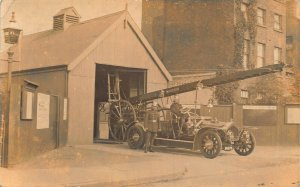 American or British Fire Station with fire engine truck real photo Postcard