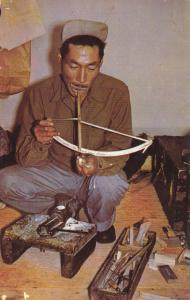 Little Diomede Eskimo, Carver with mouth drill, 40-60s