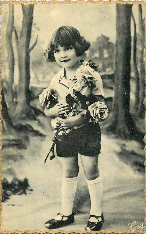 Children topic vintage postcard cute little girl with roses