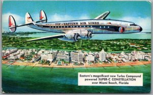 1950s EASTERN AIRLINES Aviation Postcard Super-C Constellation Over Miami Beach