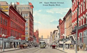 GRAND RAPIDS MICHIGAN~UPPER MONROE AVENUE-VAUDETTE-STOREFRONTS POSTCARD 1910s