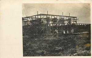 RPPC Construction Site and Workers in Aprons, Frame Boards Up~c1913 Postcard pc