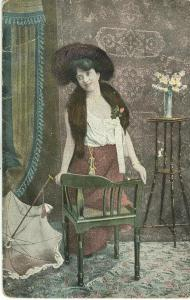 Woman standing in room, 1905 used Postcard