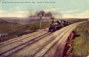 TRAIN PASSING GRANITE CANON STATION, WY. ON LINE OF UNION PACIFIC 1911