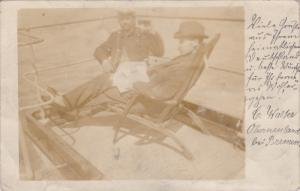 RP: Man & Ship's Officer on deck of Ship , Bremen , Germany , PU-1900
