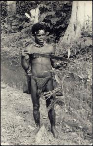 New Guinea, Native PAPUA Warrior with Machete (1950s) RPPC