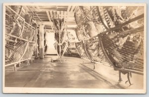 WWI Navy Ship Interior~Sailor Rack Bunks Folded Up~Stuff Inside~c1918 RPPC