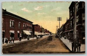 Oelwein IA~Showing the Main Streets~Kerwin's Everything~Drugs & Wallpaper~c1910