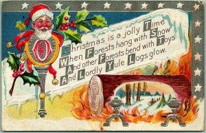 Vintage CHRISTMAS Embossed Postcard SANTA CLAUS / Yule Log / Holly 1912 Cancel
