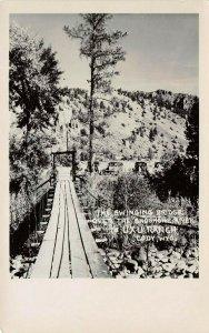 LP65   Cody Wyoming  RPPC Postcard  AUXU Ranch Cabin Tourist Cabins Bridge