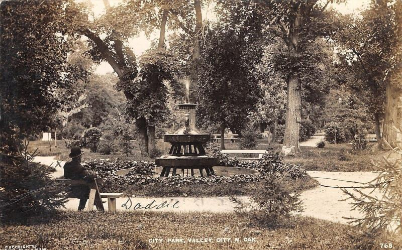 Valley City ND Daddie on Bench~Fountain~No Sleepers Here RPPC 1911 Gussy Kitzman