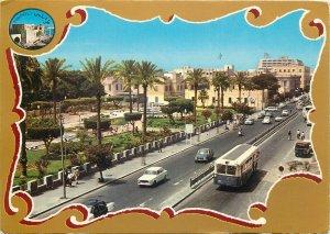 Postcard Libya Tripoli Sciara Omar el Muktar bus vintage cars traffic