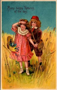 BOY & GIRL - MANY HAPPY RETURNS - FLOWERS - VINTAGE POSTCARD
