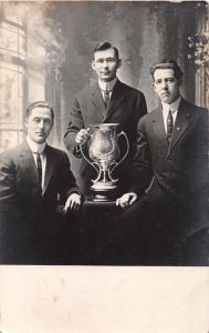 MEN WITH LOVING CUP~READS ...GUILD SOCIETY CLUB...~REAL PHOTO POSTCARD 1911