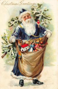 Christmas Greetings Blue Suited Santa Claus Bag of Toys Tuck Postcard