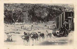 LP04  Klondike Mining  Alaska Postcard Sled Dogs RPPC copy of 1897 image